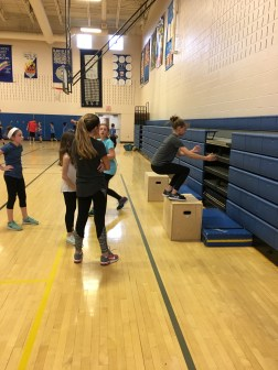 A group of girls are doing box jumps. (Photo/Jaryd Leady)
