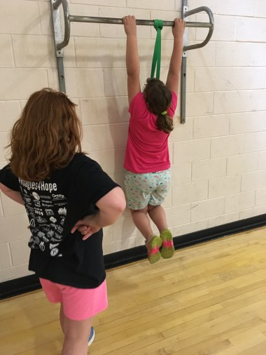 Two girls perform arm hangs as an alternate workout for pull ups. Taking turns every 10 seconds and switching. (Photo/Jaryd Leady)