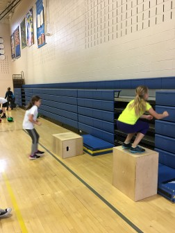 Two girls go head to head on the box jumps, on the right is great form for box jumps, landing with a perfect squat position. (Photo/Jaryd Leady)