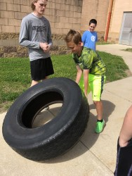 A student showing the starting position of the tire flip. (Photo/Jaryd Leady)