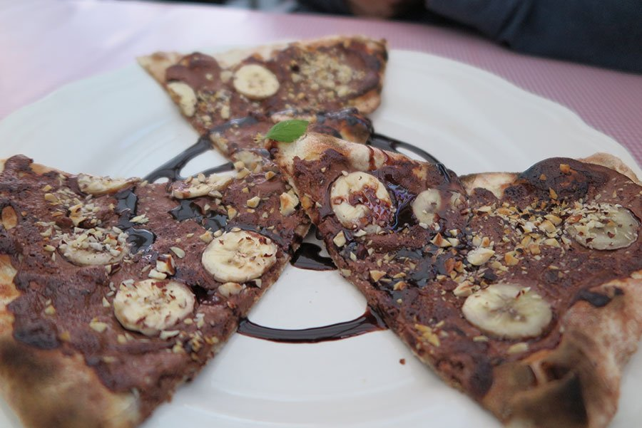Nutella pizza with bananas and hazelnuts for desert.