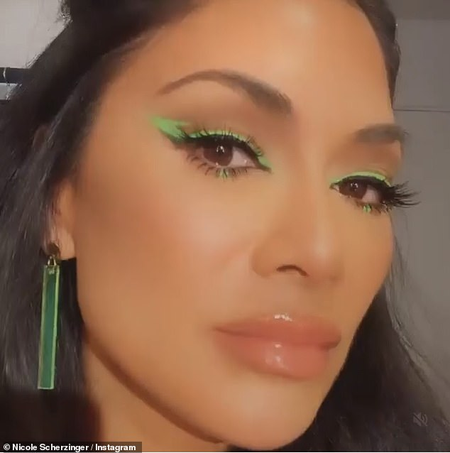 Bold: Nicole continued with the bold colour by opting for a lime green and yellow eye shadow with a distinctive cat eye detail