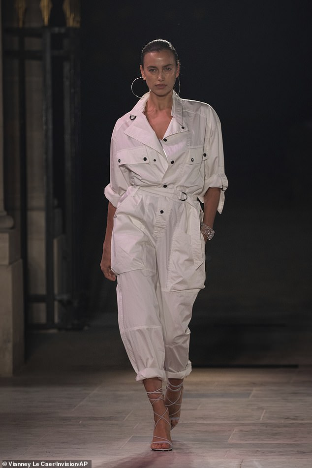 Irina just returned to her adopted hometown of New York after hitting the catwalk for Paris Fashion Week as she is shown walking for Isabel Marant on September 30