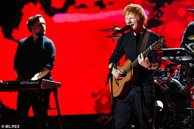 Music: Ed looked typically casual in a long-sleeved black top and dark jeans while his band played behind him