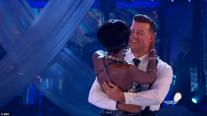 Success:AJ dazzled in a blue and silver gown as she took to the floor for the incredible dance and impressed the judges, with Motsi and Shirley giving her a standing ovation