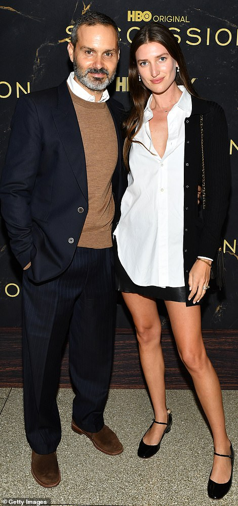 Cozy: Ned Benson and his date for the night Michelle Ouelle struck a cozy pose on the carpet