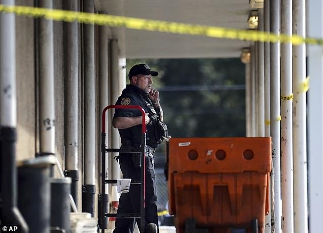 The street leading to the East Lamar Carrier Annex complex in the Orange Mound neighborhood of Tennessee was blocked off by police following the shooting as the FBI, the U.S. Postal Inspection Service and other federal authorities carried out an investigation