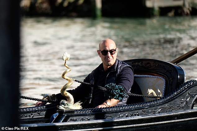 New show: The actor, 60, enjoyed a gondola ride along the canal while a camera crew filmed him for his series Searching for Italy