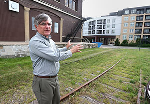 """""""You stand on Hampden [Avenue] and you see these rail lines disappear into"""" the Lyric on Carleton Place apartments in St. Paul, says Craig Blakely, whose Art Train proposal is one of three finalists for a $1 million grant from the Forever Saint Paul Challenge. (Staff photo: Bill Klotz)"""