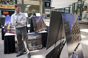 Architect Jonah Ritter looks over the conceptual art for a number of planned downtown residential projects on display at the 14th annual Building Community expo in the IDS Crystal Court. (Photo: Matt M. Johnson)