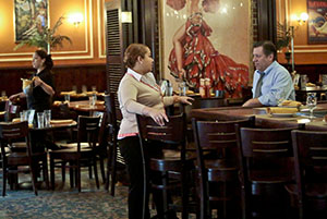 Jeremy Merrin, right, owner of Havana Central restaurants, speaks with general manager Rosalyn Rentas in New York. Merrin said that while he supports health care reform, the current law will hurt small businesses like his. (AP Photo: Bebeto Matthews)