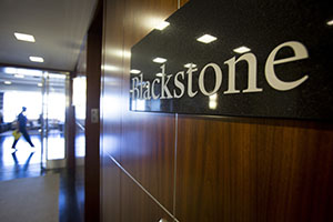 The Blackstone Group LP logo hangs in the company's offices in New York. (Bloomberg News photo: Scott Eells)