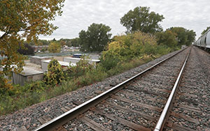 Planners say a $60 million plan to shift Canadian Pacific-owned freight tracks farther north in the Southwest Light Rail Transit corridor would allow for more access and development potential along the line. St. Louis Park officials view sites like the one pictured above, near Louisiana Avenue and Oxford Street, as key to development efforts. (Staff photo: Bill Klotz)
