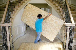 A contractor installs plywood over sub-flooring at a home under construction at a Toll Brothers development in Glenelg, Md. Toll, which has acquired land at a lower cost, is poised to do better than some peers in this economic cycle. (Bloomberg News: Andrew Harrer)