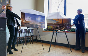 Julie Snow, left, of Minneapolis-based Julie Snow Architects, and St. Paul Saints team vice president Annie Huidekoper unveil the latest drawings of the proposed $63 million ballpark Thursday. (Staff photo: Bill Klotz)