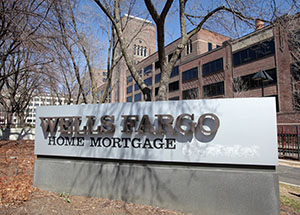 Wells Fargo, which made almost 28 percent of all mortgages in 2012, announced more than 6,200 job cuts last year. Its share dropped to less than 20 percent in the third quarter. (File photo: Bill Klotz)