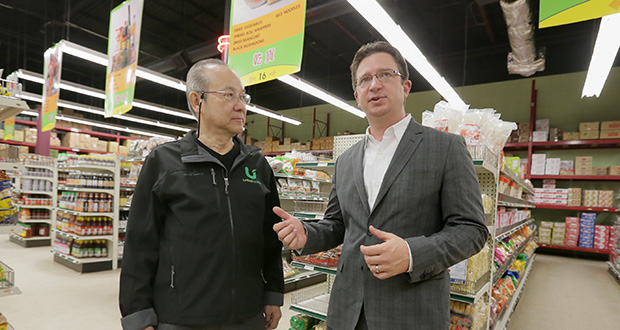 Jeremy Kalin (right), president of Eutectics Consulting LLC, stands with Ramon Tan, owner of United Noodles in south Minneapolis. The United Noodles solar-energy project, facilitated by Eutectics' SolarNote program, cost $260,000, but rebates dropped it to $180,000, Kalin says. Tan will pay slightly more than $40,000 for panels after tax incentives are figured into the equation. (Staff photo: Bill Klotz)