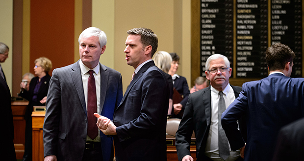 House Speaker Paul Thissen, left, and Minority Leader Kurt Daudt talk Tuesday, Feb. 25, just before the start of the 2014 legislative session in St. Paul. Thissen told business leaders at the Minnesota Chamber of Commerce Session Priorities event that day that they won't be getting some of the biggest items on their wish list. (AP Photo: The Star Tribune, Glen Stubbe)
