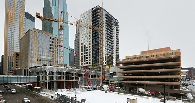 New apartment projects such as Opus Group's 253-unit Nic on Fifth (center) in Minneapolis are expected to raise vacancy rates in downtown Minneapolis. Mortenson Development is expected to begin construction soon on the 262-unit 4Marq apartment tower (foreground). (Staff photo: Bill Klotz)