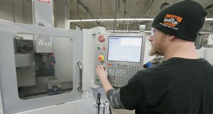 Machine technology student Aaron Glanz works with a computer-controlled milling machine at the Dunwoody College of Technology in Minneapolis, which offers a number of CNC-related programs. (Staff photo: Bill Klotz)