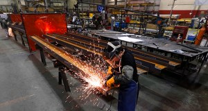 Jesus Rodriguez grinds steel Jan. 23, 2014 at the IDEAL Group in Detroit. (AP photo: Paul Sancya)