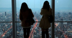 Women look out at the skyline from the observation deck of the Abeno Harukas building in Osaka, Japan, on Tuesday, March 4. (Bloomberg News photos: Yuzuru Yoshikawa)