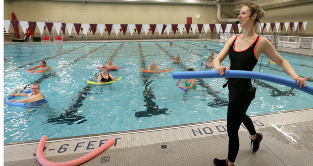 Megan Munoz, a community center group fitness instructor, leads an aquatic fitness class Thursday at the Eden Prairie Community Center, 16700 Valley View Road. The city could break ground as soon as June on a $19.4 million aquatics center to replace the existing pool. (Staff photo: Bill Klotz)