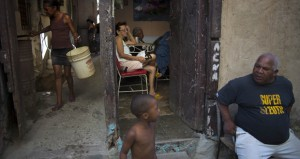 People talk on the doorstep of their house in Havana, Cuba, on April 12. Official government statistics show new construction has actually declined since Raul Castro assumed the presidency from his older brother Fidel in 2008. (AP photo: Ramon Espinosa)