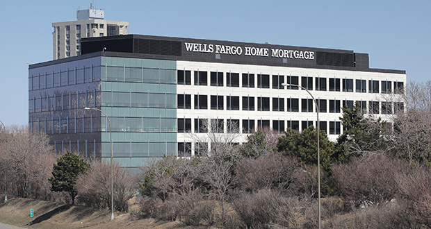 At Wells Fargo, home-loan originations exceeded $100 billion for seven straight quarters, ending in June 2013. The figure plunged to $36 billion in the three months through March, the San Francisco-based bank said April 11. Locally, the Wells Fargo Mortgage campus is at 26th Street and I-35W in Minneapolis. (File photo: Bill Klotz)