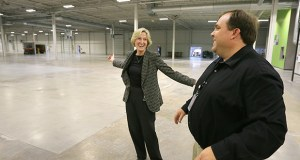 Vicki Holt, CEO of Maple Plain-based Proto Labs, and Mike Kenison, the company's vice president of manufacturing, show off a 166,350-square-foot facility the manufacturer opened last month at 2600 Niagara Lane in Plymouth. Manufacturers like Proto Labs are optimistic about the future but face challenges with hiring workers. (File photo: Bill Klotz)