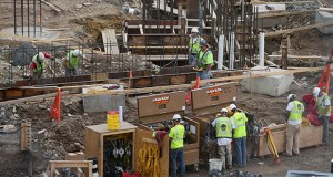 Construction workers pour concrete Tuesday on the western side of the Vikings stadium project site in Minneapolis. (Staff photo: Bill Klotz)