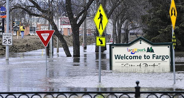 The bill authorizes spending up to $800 million for a flood diversion project that would protect the Red River Valley region of North Dakota and Minnesota. This photo shows flooding in Fargo in April 2011. (AP Photo)