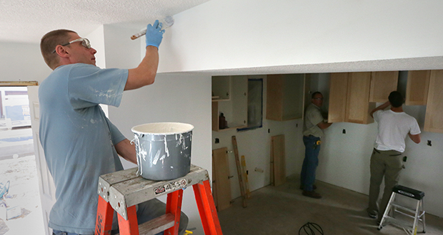 Erric Carty, a student in the Goodwill/Easter Seals Construction Training Program, paints the living room in a home at 462 Edmund St. in St. Paul's Frogtown neighborhood. Goodwill/Easter Seals and Urban Homeworks are building the home on one of 240 properties the St. Paul Housing and Redevelopment Authority is selling. (Staff photo: Bill Klotz)