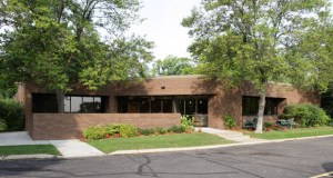 An entity related to Wooddale Builders has acquired this 10,500-square-foot office building at 6117 Blue Circle Drive, Minnetonka, for $1.2 million. (Submitted photo: CoStar)