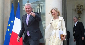 General Electric Co. CEO Jeffrey Immelt, left, and GE France Chairwoman Clara Gaymard leave the Elysee Palace after a meeting with French President Francois Hollande on Friday. (AP photo)