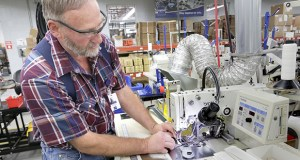 Capital Safety employee Wayne Voth assembles a harness at the equipment maker's plant in Red Wing. (File photo: Bill Klotz)