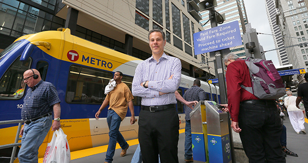 """""""I'm still a real estate developer -- I just happen to work for the government these days,"""" says David Frank, the city of Minneapolis's first transit oriented development manager, standing near the Nicollet Mall light rail station in downtown. (Staff photo: Bill Klotz)"""