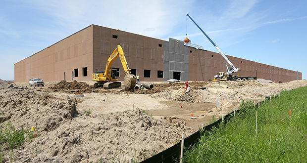 Duke Realty is developing a 300,000-square-foot warehouse along Queens Avenue in Otsego. The project, to be occupied by Ruan Transportation Management Systems, is expected to be complete in October. (Staff photo: Bill Klotz)