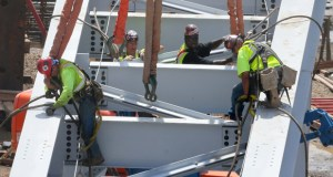 Workers on Friday assemble a steel beam for the roof of the new Vikings stadium in downtown Minneapolis. A massive crane that will set steel beams for the roof is scheduled to arrive June 30. The crane will be delivered in 65 truckloads and it will take roughly three weeks to put it together. (Staff photo: Bill Klotz)