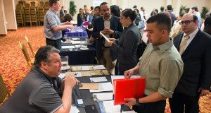 Bob Truncali, of DeVry College, left, talks with job seeker James Echeverry, of Queens, at a career fair May 13 in New York. Employers added 217,000 jobs in May, putting the economy on pace for an average monthly gain of 214,000 that would make 2014 the best performance in 15 years. (Bloomberg News)