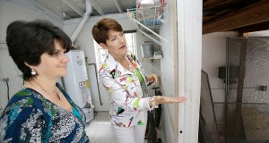 In this May 29 photo, real estate broker Nancy Dowson, right, shows a house to prospective buyer Mary Tuttle in Miami Shores, Florida. (AP photo)
