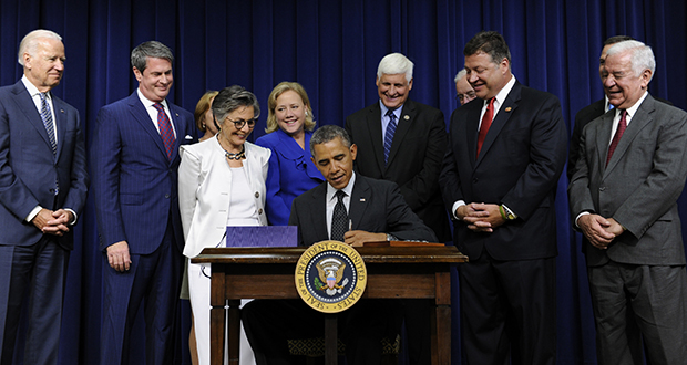 President Barack Obama signs the Water Resources Reform and Development Act of 2014 on Tuesday in Washington. From left are , Vice President Joe Biden; Sen. David Vitter, R-Louisiana; Sen. Barbara Boxer, D-California; Sen. Mary Landrieu, D-Louisiana; Rep. Bob Gibbs, R-Ohio; Rep. Bill Shuster, R-Pennsylvania; and Rep. Nick Rahall, D-West Virginia. (AP photo)