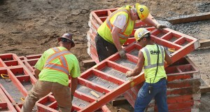 Construction workers set up concrete forms Thursday for the first building in the $420 million Downtown East project site in downtown Minneapolis. Despite some big projects, Minnesota lost 100 construction jobs in June. (Staff photo: Bill Klotz)
