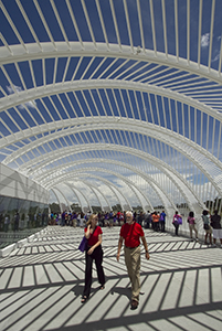 Visitors stroll along the East Terrace on the second level of Florida Polytechnic University's Innovation, Science and Technology Building on July 12 in Lakeland, Fla. When it opens in August 2014, the school will be Florida's 12th state university and the only one dedicated almost exclusively to producing science, technology, engineering and math degrees. (AP Photo: The Lakeland Ledger, Michael Wilson)