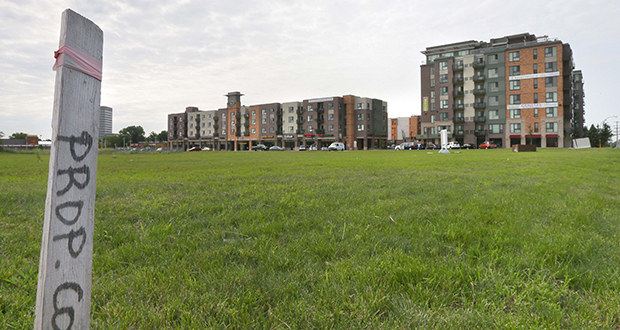 United Properties plans to develop three vacant acres at 8001 Penn Ave. S., just south of the 234-unit Genessee apartments and townhomes (background). The new development will include a hotel, grocery store and retail space. (Staff photo: Bill Klotz)