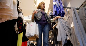 Sustained hiring is making Americans more comfortable opening their wallets. In this photo taken May 14, Jody Dickman shops at a Gap store in Pittsburgh. (AP photo)