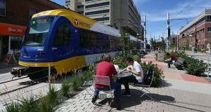 Open space in the middle of Washington Avenue has benches and tables for public use near the East Bank light rail station on the University of Minnesota campus in Minneapolis, which has the highest proportion of park and open space on the Green Line. (Staff photo: Bill Klotz)