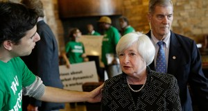 Federal Reserve Chair Janet Yellen, right, speaks with Ady Barkan, of the Center for Popular Democracy, as she arrives for a dinner Thursday during the Jackson Hole Economic Policy Symposium near Jackson, Wyoming. (AP photo: John Locher)