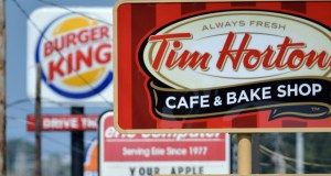 Signs for a Tim Hortons restaurant, foreground, and a Burger King restaurant are displayed along Peach Street in Erie, Pennsylvania. (AP photo)