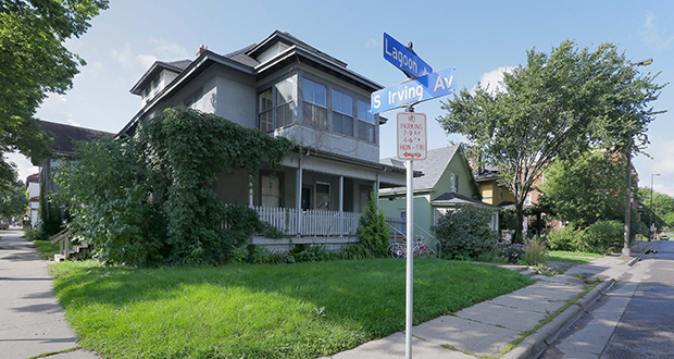 The houses at 1609 and 1611 Lagoon Ave. and 2910 Irving Ave. S. in Minneapolis could be torn down to make way for an apartment project. (Staff photo: Bill Klotz)